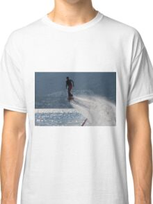 Flyboarder followed by spray over backlit sea Classic T-Shirt