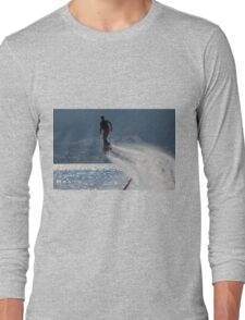 Flyboarder followed by spray over backlit sea Long Sleeve T-Shirt