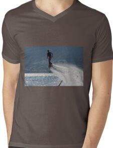 Flyboarder followed by spray over backlit sea Mens V-Neck T-Shirt