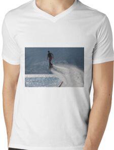 Flyboarder followed by spray over backlit sea Mens V-Neck T-Shirt