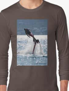 Flyboarder leaning into turn over backlit waves Long Sleeve T-Shirt