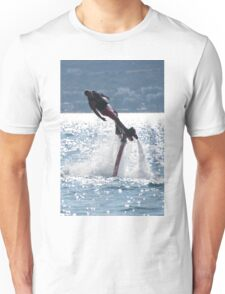 Flyboarder leaning into turn over backlit waves Unisex T-Shirt