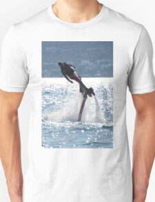 Flyboarder leaning into turn over backlit waves T-Shirt