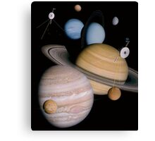 VOYAGER, Montage of planets and some moons the two spacecraft have visited and studied Canvas Print