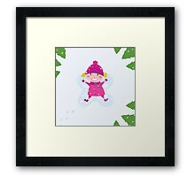 Happy blond girl making angel in snow Framed Print