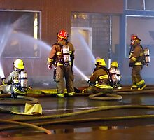 Firefighters Sitting Down on the Job to Get 'er Done by Erick Sodhi
