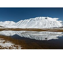 Sibillini mountains reflected in the water with snow Photographic Print