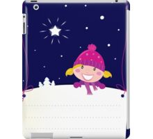 Cute christmas blond hair girl holding a blank banner label for message iPad Case/Skin