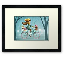 Girl riding a bike Framed Print