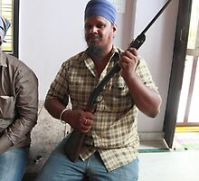 Sikh Posing with Rifle by Andrew  Makowiecki