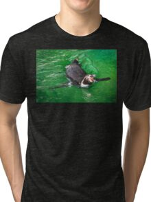 Penguin out for a swim in the green ocean Tri-blend T-Shirt
