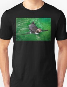 Penguin out for a swim in the green ocean Unisex T-Shirt