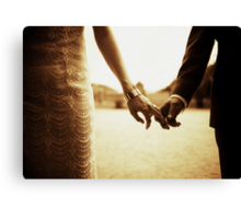 Bride and groom holding hands in sepia - analog 35mm black and white film photo Canvas Print