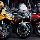 A Trio of Colourful Motorcycles by Gerda Grice