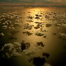 Clouds & Reflections Over the Ocean by AnnDixon