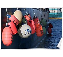 Photo of Fishing Buoys Hanging Over a Boat Railing Poster