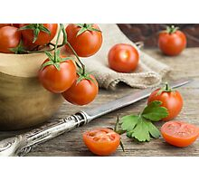 Heap of cherry tomatoes in bowl, with knife Photographic Print
