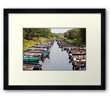 rowing boats moored near ross castle Framed Print