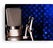 Silver microphone on black and blue background Canvas Print