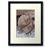 the old wooden wagon wheel Framed Print