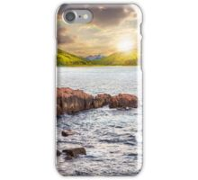 mountain lake with rocky shore at sunset iPhone Case/Skin