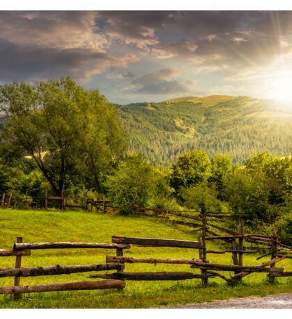 wooden fence on hillside at sunset Sticker