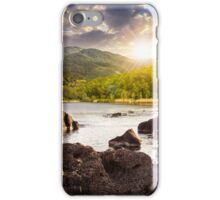 lake shore with stones near forest on mountain at sunset iPhone Case/Skin