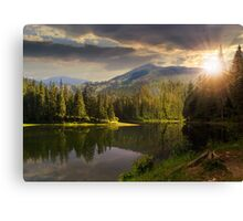pine forest near the mountain lake at sunset Canvas Print