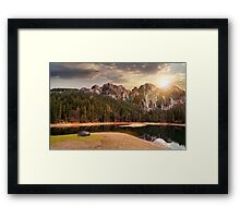 lake near the mountain in pine forest at sunset Framed Print