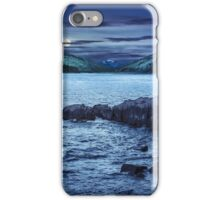mountain lake with rocky shore at night iPhone Case/Skin