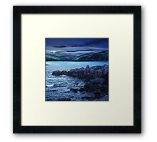 mountain lake with rocky shore at night Framed Print