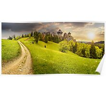 path to fortress ruins on hillside with forest at sunset Poster
