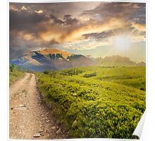 gravel road to high mountains at sunset Poster