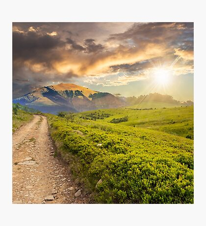 gravel road to high mountains at sunset Photographic Print
