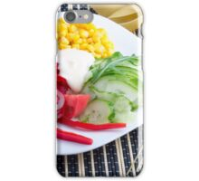 Slices of fresh raw vegetables on a striped background iPhone Case/Skin