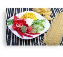 Slices of fresh raw vegetables on a striped background Canvas Print