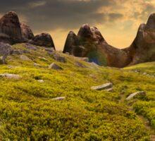 path through boulders on hillside at sunset Sticker