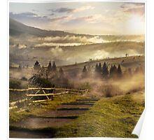 steps down to village in foggy mountains at sunset Poster