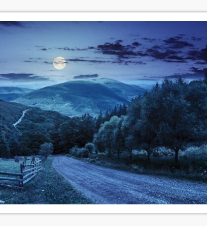 fence near road down the hill with  forest in mountains at night Sticker