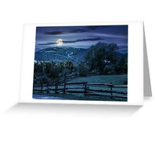 wooden fence on hillside at night Greeting Card