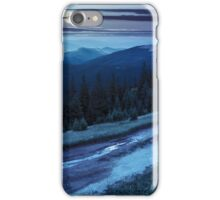 road through conifer forest in mountains at night iPhone Case/Skin