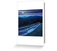 road through conifer forest in mountains at night Greeting Card