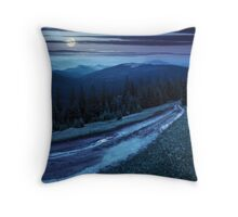 road through conifer forest in mountains at night Throw Pillow