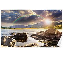 lake with boulders in mountains at sunset Poster