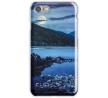 lake shore with stones near pine forest on mountain at night iPhone Case/Skin