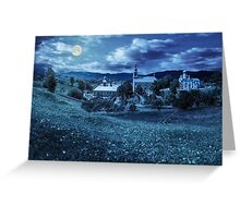 Monastery on the hillside at night Greeting Card