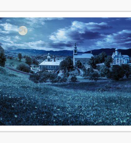 Monastery on the hillside at night Sticker