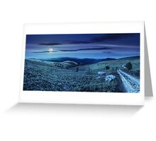 road on hillside meadow in mountain panorama at night Greeting Card