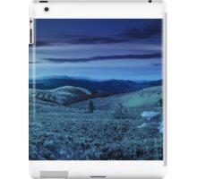 road on hillside meadow in mountain panorama at night iPad Case/Skin