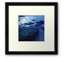 gravel road to high mountains at night Framed Print